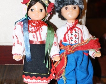 Vintage Plastic European Boy and Girl Souvenir dolls In full Ornate Costume.  In MINT Condition