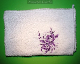 Towel with flower motif
