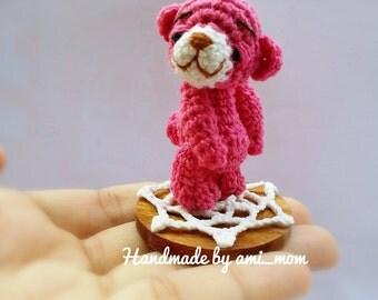 Crochet Tiny bear 5 cm. On a doily.