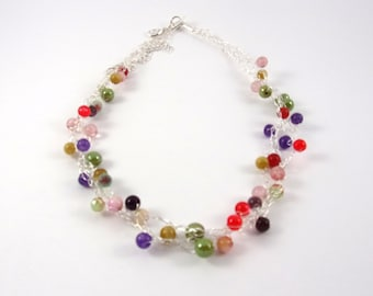 silvery necklace with multicolored pearls , silvery wire .