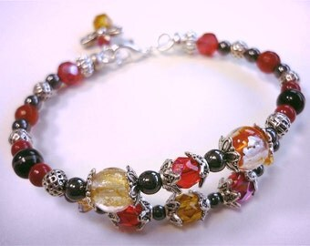 Red beaded bracelet with lampwork