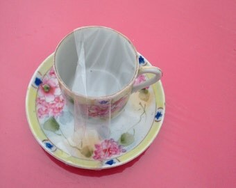Dainty vintage cup and saucer