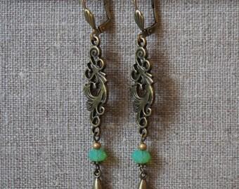 Green dangling earrings