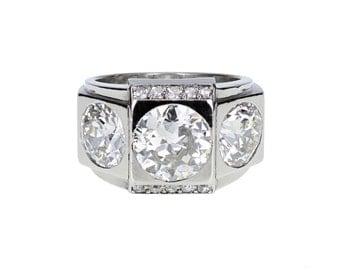 1930s Boucheron Three Stone Diamond Ring in Platinum