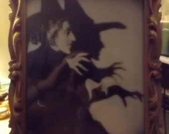 wicked witch photo in antique wood frame.