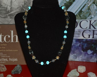 Dark Grey and White Crystals, Iridescent Blue, and Yellow with Blue Spotted Beads