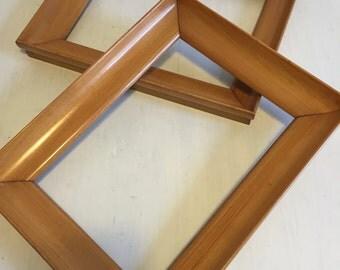 2 blond wood frames