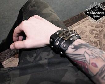 Black, leather, wrap around studded bracelet. Handmade, one of a kind!