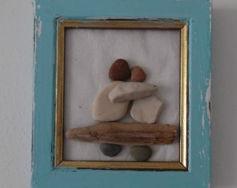 A couple in love siiting on the bench, Pebble art,Driftwood