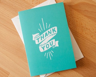 Thank You Greeting Card with envelope. Hand lettering illustration. Teal and white banner with sunburst.