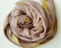 Beautiful tan scarf/hijab with gold border and subtle sparkles
