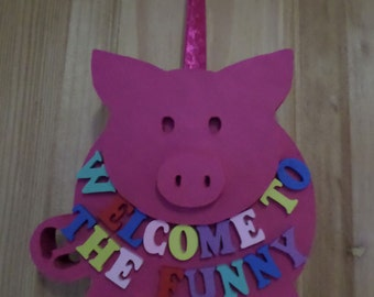 Welcome to the funny farm hanging pig
