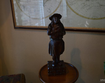 Mid 1800's - Wooden statue of a man holding a Brittany bagpipe