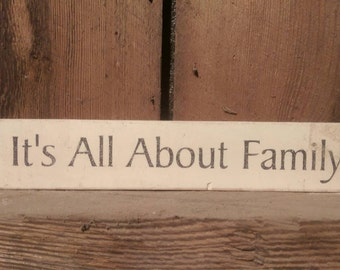 "Sign painted ""It's all about family"""