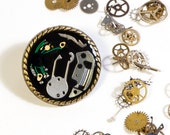 "Broche ""Tic-Tac"" con maquinarias de relojes"
