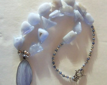 Blue Chalcedony nugget necklace with sterling silver encased pendant.