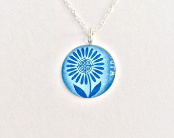 Swiss Miss: Sterling Silver and Resin Pendant Necklace