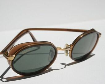Rare vintage RAYBAN gold, Bronze, copper, metallic brown leather explore Glacier sunglasses