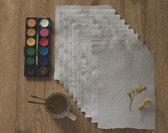 Handmade recycled paper. (10 sheets)