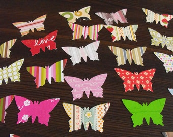 Butterflies embellishments punched from patterned scrapbook papers