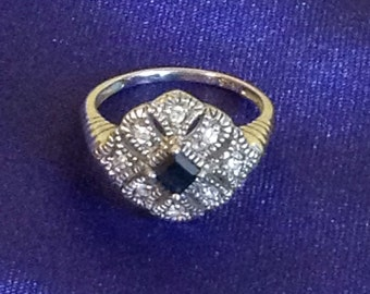 Sapphire and topaz ring