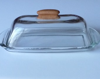 Butter dish with a hand carved wooden handle