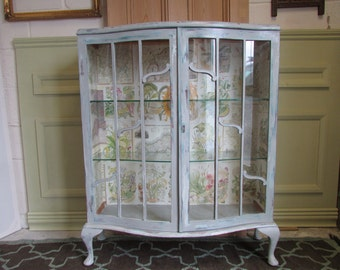 A 1920's hand painted display cabinet.