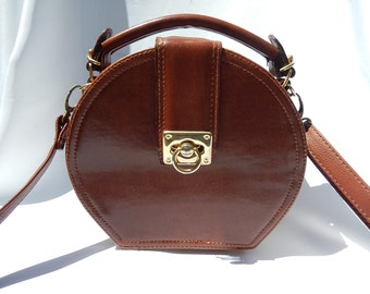 Old leather bag, woman