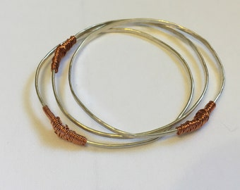 Hammered sterling silver and copper wire wrap bangles (set of 3)