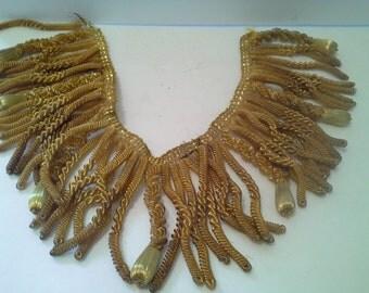 Small piece of metallic threads fringe