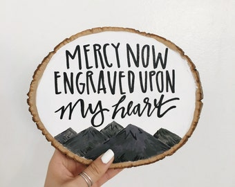 Wood slice with mountains and customizable quote