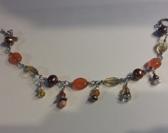 Sterling bracelet with carnelian, citrines, bronze pearls and angel skin coral