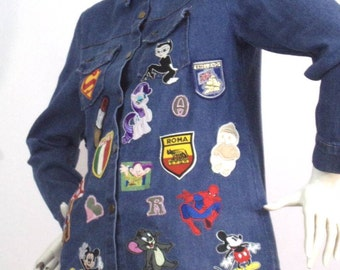 short blue jacket with patches size M