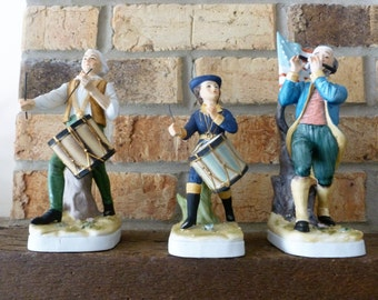 Porcelain Drummers and Flute Player Figurines