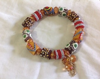 African bead bracelet with charms.