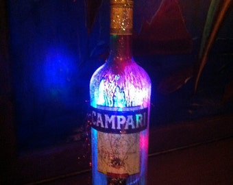lighted bottle of campari