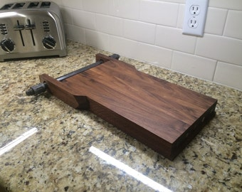 Black walnut cutting board with magnetic knife holder