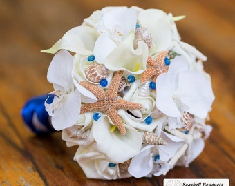 Seashell bouquet with orchids calla lilies roses, shells and starfish, royal horizon blue beach wedding, flower bouquet with shells