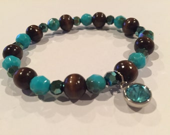 Brown and Blue beaded Stretch bracelet with Jewel charm