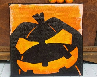 "Canvas ""Halloween"" with Jack O'Lantern and small pumpkins"