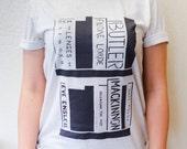 Your Feminist Bookshelf: hand printed original design Triblend soft t-shirt