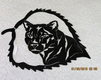 cougar in a leaf