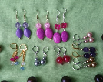 9 pairs of earrings, pressured stones.