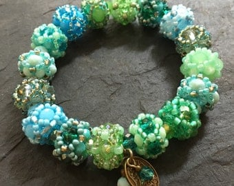 Tohoperlen bracelet in many different green/turquoise tones
