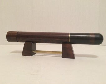 This is a 1950s made out of Rosewood kaleidoscope with brass  accents