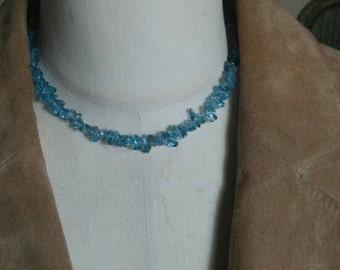 Blue glass necklace.