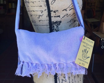 Woven clutch bag to the frame