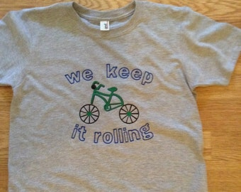 We keep it rolling Fuego Youth shirt