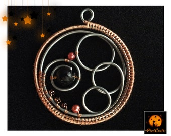 Pendant with spirals and beads