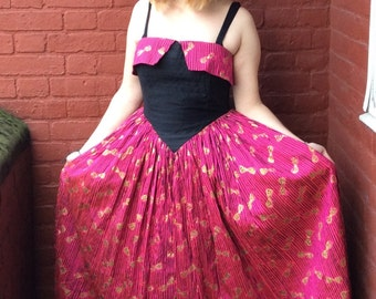 80s does 50s bow print ball gown